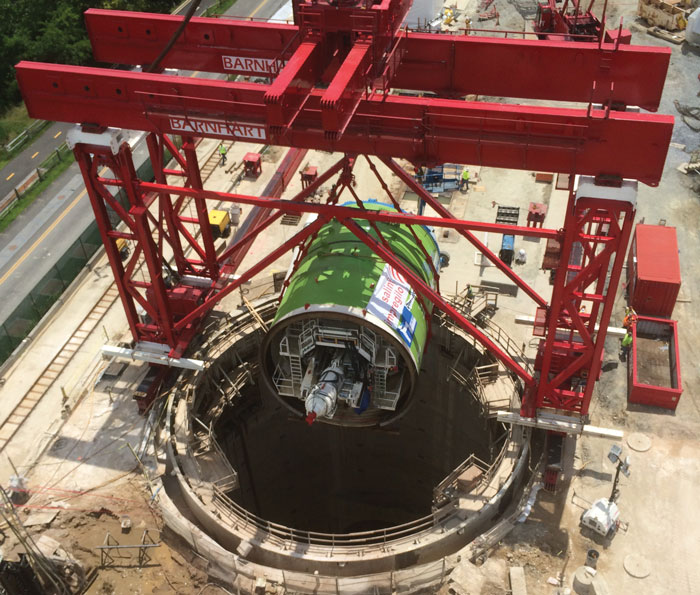 The photo of the Herrenknecht TBM being lowered into the shaft to build the Anacostia River Tunnel in Washington, D.C.
