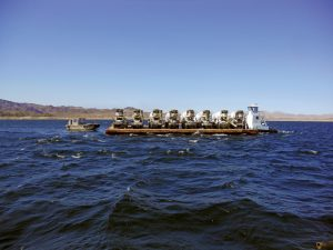 To secure the intake structure, a carefully timed concrete pour was executed from barges ferried into the lake.