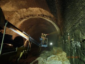Shotcrete being applied in a tunnel.